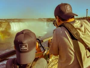 Father and son taking pictures of Niagara Falls